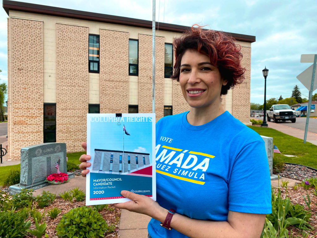 Amáda Márquez Simula registers as a candidate in front of the Columbia Heights City Hall.
