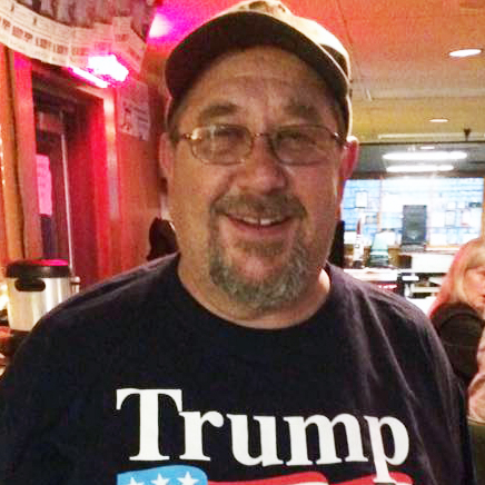 Mike Novitsky wears a MAGA hat and Trump 2020 T-shirt