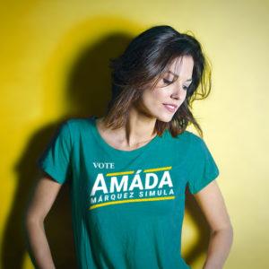 Woman wearing a teal Vote Amáda Márquez Simula T-shirt