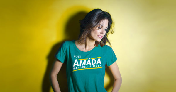 Woman wearing a teal Vote Amáda Márquez Simula T-shirt