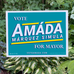 "Teal campaign lawn sign that reads ""Vote Amáda Márquez Simula for Mayor"""