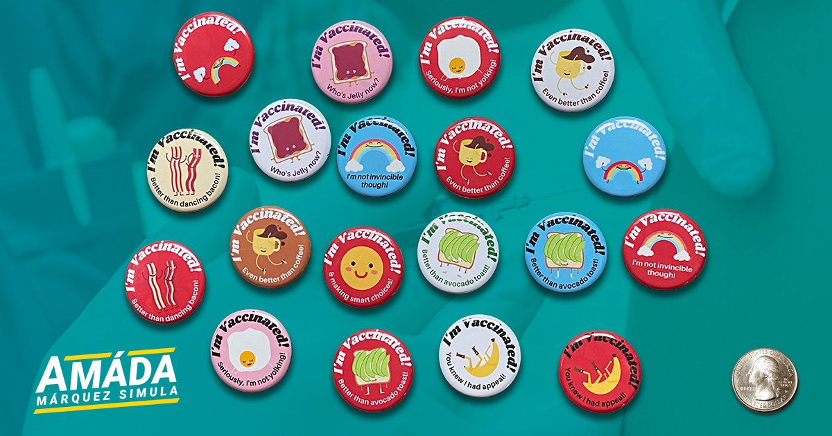 A variety of small pins that read I'm vaccinated, designed by Amáda Márquez Simula